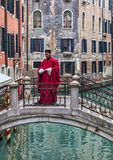 Roman Character. Venice, Italy- February 19th, 2012: Image of a man disguised as a Roman character on a small bridge over a channell in Venice during the Royalty Free Stock Image