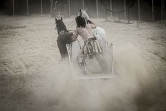 Roman chariot in a fight of gladiators, bloody circus Stock Photo