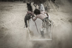 Roman chariot in a fight of gladiators, bloody circus Royalty Free Stock Image