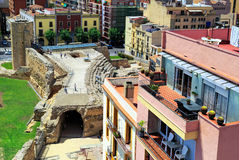 Roman circus and Tower of nuns. Tarragona, Spain. The Roman circus and the Tower of nuns of the 14th century, surrounded by typical spanish residential houses Royalty Free Stock Photo