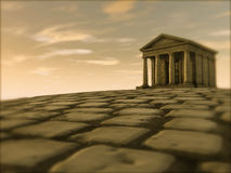 Roman cobble stone and temple on hill Royalty Free Stock Photos