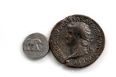 Roman Coins. Two Roman coins depicting Sestertius of Nero showing the portrait of a Roman soldier on a white background Stock Photos