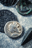 Roman coins and arrowhead Royalty Free Stock Images