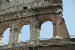 Roman Coliseum. Daytime image of the Roman Coliseum with bright sun and partly cloudy skys Stock Photography