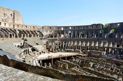 Roman Coliseum from inside, people watching and visiting this great symbol of ancient architecture Royalty Free Stock Photo
