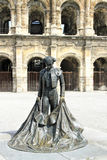 Roman Coliseum - Nimes, France. Roman Coliseum with a statue of a bullfighter- Nimes, France Stock Images