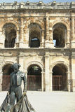 Roman Coliseum - Nimes, France. Roman Coliseum with a statue of a bullfighter- Nimes, France Stock Photos