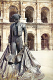 Roman Coliseum - Nimes, France. Roman Coliseum with a statue of a bullfighter- Nimes, France Royalty Free Stock Images