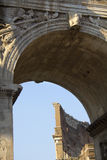 Roman Coliseum seen through the Arch of Constantine. Architectural detail of the Roman Coliseum in Rome, Lazio, Italy. The Coliseum is seen through the opening Royalty Free Stock Photography