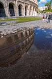 Roman Colloseum in Rome. Rome, Italy - April 5, 2019: The Roman Colloseum or Flavian Amphitheather reflecting on rain water on the ground in Rome, Italy stock photos