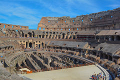 Roman colosseum with blue skies. Roman colosseum or coliseum in Italy royalty free stock photography
