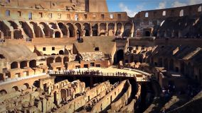 Roman Colosseum. The Colosseum or Coliseum, also known as the Flavian Amphitheatre, is an oval amphitheatre in the centre of the city of Rome, Italy. Built of stock video footage