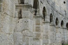 Column of Roman colosseum in the Croatian town of Pula. The great amphitheatre, Pula Arena royalty free stock image