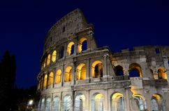 Roman Colosseum illuminated at night Stock Photo