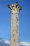 Roman column. Ancient Roman Column with a Corinthian capital isolated on blue sky. Pompeii,Italy Royalty Free Stock Photo