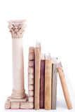 Roman column bookend and old books Stock Photo