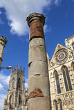 Roman Column in York. The historic Roman Column with York Minster in the background in York, England Stock Photography