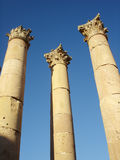 Roman Columns. Three Roman columns with blue sky Stock Images
