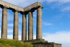 Roman columns against the sky. Roman columns over blue sky background Royalty Free Stock Photos