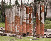 Roman columns in archaeological park in Aquileia, Italy Stock Images