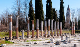Roman columns and belfry of Aquileia Stock Photos