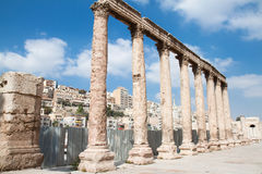 Roman columns in front of  amphitheater in Amman Royalty Free Stock Photo