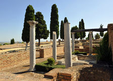 Roman columns of the house of birds, archaeological site of the Roman city of Italica, Andalusia, Spain Royalty Free Stock Photos