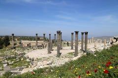 Roman Corinthian columns in Umm Qais (Umm Qays) --is a town in northern Jordan near the site of the ancient town of Gadara. Stock Photos