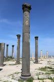Roman Corinthian columns in Umm Qais (Umm Qays) --is a town in northern Jordan near the site of the ancient town of Gadara. Stock Photo