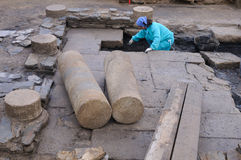 Roman domus. Asturias. Working in the patio of the  Domus  Archaeological site  Chao Samartin  Asturias SPAIN Royalty Free Stock Photo