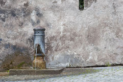Roman drinking fountain Stock Image