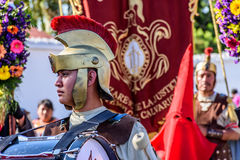 Roman with drum in Lent procession, Antigua, Guatemala. Antigua, Guatemala -  March 19, 2017: Locals dressed up as Romans & penitents in Lent procession in Royalty Free Stock Images