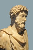 Roman Emperor. Marble bust of the roman emperor Marcus Aurelius isolated against a gray background Stock Image