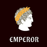 Roman emperor Julius Caesar in wreath. Roman emperor Julius Caesar head profile with golden laurel wreath on dark brown background with caption Emperor below stock illustration