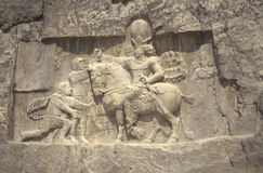 Roman Emperor Valerian submits. To Persian King Shapur, wall carving,Naqsh-e RustamIran Stock Photo