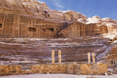 Roman-era amphitheater carved into the pink sandstone at Petra Stock Image