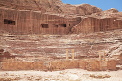Roman-era amphitheater carved into the pink sandstone at Petra, Jordan Stock Photography