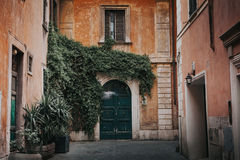 Roman facade in Italy. Classic facade and door in Rome city center stock image