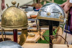 Roman fighting helmets. Roman combat helmets exposed at an antique arms exhibition Royalty Free Stock Photography