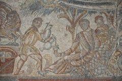 Roman floor mosaic. Tile detail slave serving wine Stock Photography