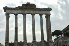 Roman Forum 3. Front view of the temple of Saturn, (498 AD) on the Roman Forum at sundown on a cloudy sky, Rome, Italy stock image