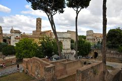 Roman Forum. Arch of Constantine, Temple of venus and Rome, Colosseum Stock Photo
