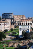 Roman Forum and Colosseo in Roma. The Roman Forum known by its original Latin name (Forum Romanum), is located between the Palatine hill and the Capitoline hill Stock Photography