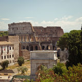 The Roman Forum and Colosseum, Rome, Italy. A long view over the ancient Roman Forum ruins with the familiar view of the Colosseum in the distance Royalty Free Stock Images