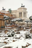 The Roman Forum covered by snow. A really rare event in Rome. In the background the Altar of Motherland stock image