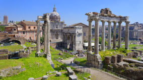 Roman Forum in Italy. Ruins of the Septimius Severus Arch and Saturn Temple in the Roman Forum, Foro Romano, Rome, Italy royalty free stock image