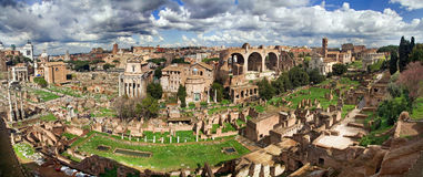 The Roman Forum from Palatine hill, panorama. Panoramic view from Palatine hill to Roman Forum with all details startig from Temple of Saturn (on the right) to Royalty Free Stock Photography