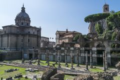 Roman Forum ruins in Rome, Italy. The Roman Forum is a rectangular forum surrounded by the ruins of several important ancient government buildings at the center Royalty Free Stock Photos