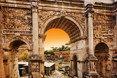 Roman Forum, Rome Italy. Roman Forum, The Arch of Septimius Severus at Sunset, Rome - Italy Stock Photo