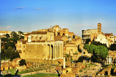 Roman Forum in Rome, Italy. ROME, ITALY - APRIL 17: Roman Forum with the Coliseum in the background on April 17, 2013 in Rome, Italy. The Coliseum is an iconic Stock Images
